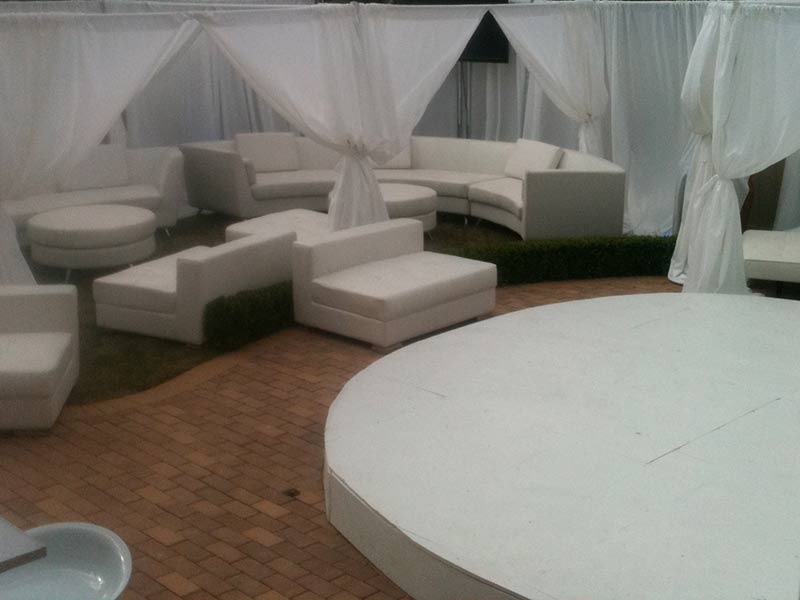 Privacy-booths-with-pipe-and-drape-and-white-event-furniture