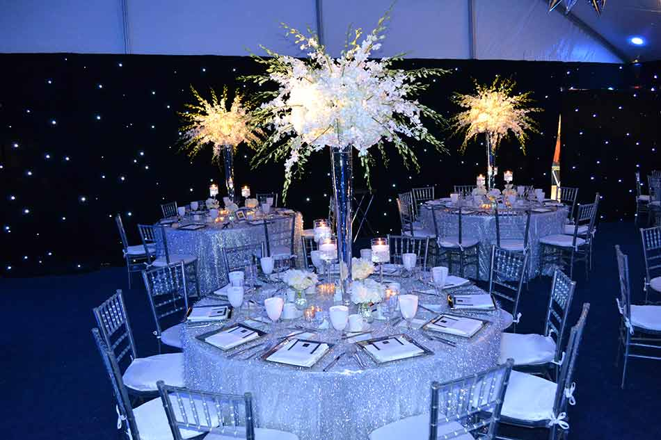 Starry-sky-pipe-and-Drape-with-round-event-tables-and-sparkle-tablecloths