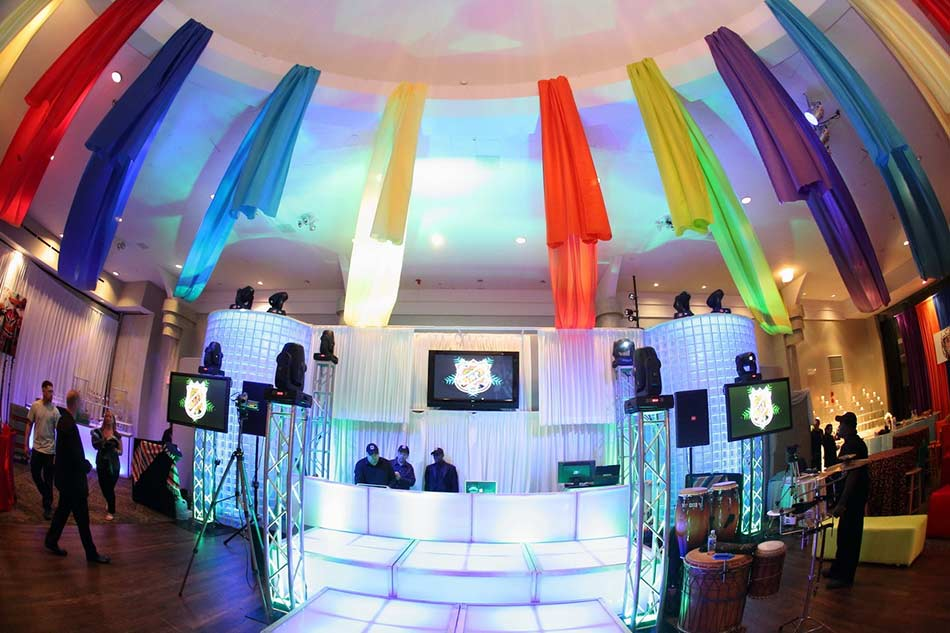 creative-draping-various-colors-on-ceiling-beam-with-LED-stagedecks-DJ-platform-Video-and-drape-background