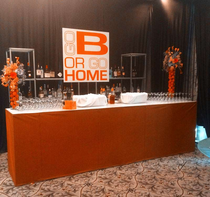 Bar-with-tailored-skirt-backboard-sign-and-glass-shelves