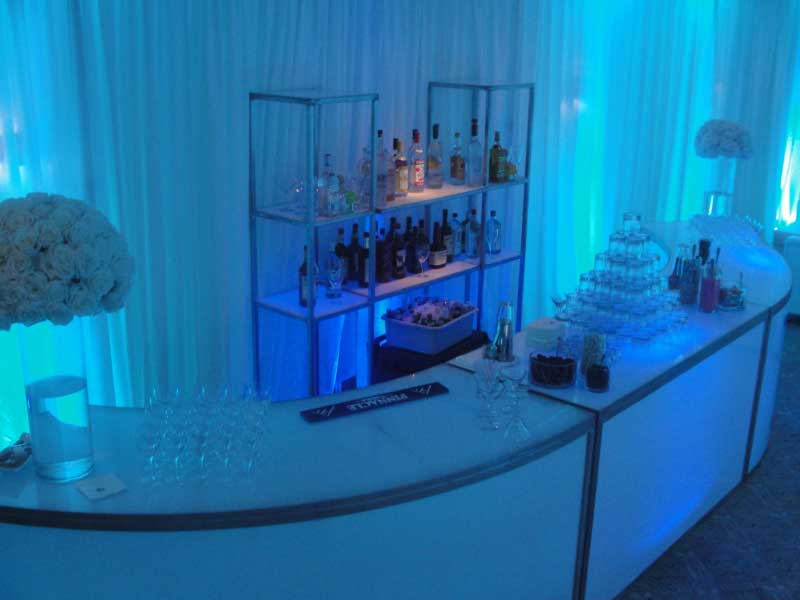 Full-illuminated-bar-with-rounded-ends-with-pipe-and-drape