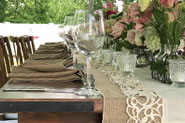 Wedding event production with rustic table setting and lighting